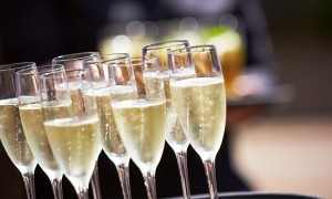Glasses full of champagne on a tray
